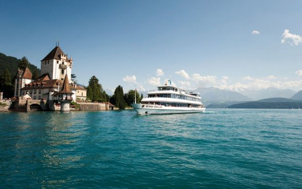 "Cruise boat ""MS Berner Oberland"" in front oft he Castle of Oberhofen"