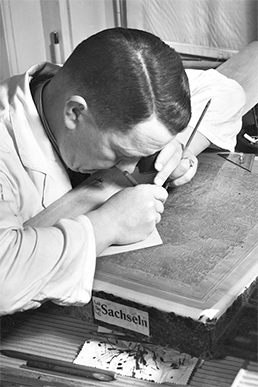Cartographer working on a lithography stone