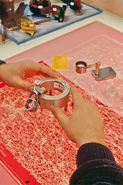 Cartographer using a special tool for glass engraving