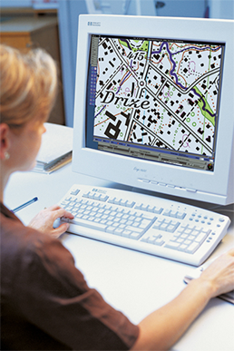 Cartographer working on a PC
